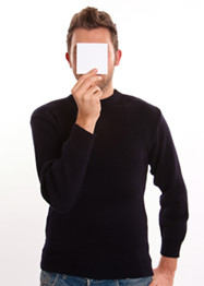 Young Man with a blank paper hiding his face